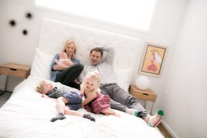Discipline: happy family on a bed